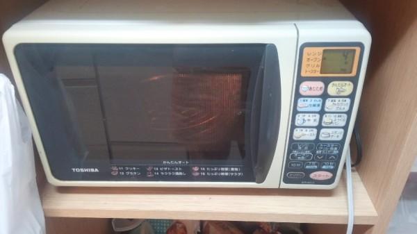 オーブンの予熱をセットしています